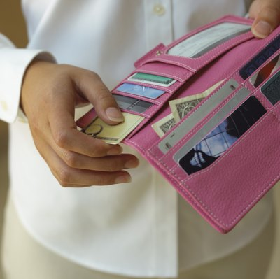 Overspending with credit cards can lower credit scores.