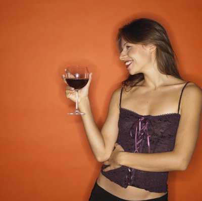 The occasional glass may not hurt, but alcohol and a flat tummy don't often go hand in hand.