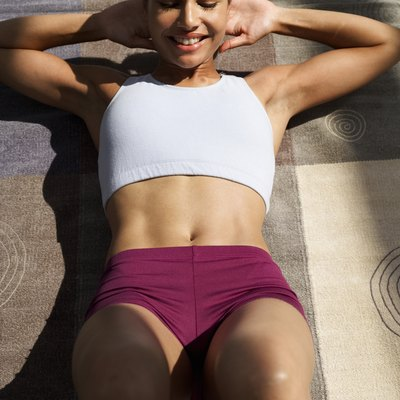 Target your abs and thighs at the same time.