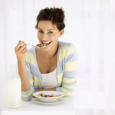 Low-fat milk, whole grains, fruits and other whole foods promote belly-fat loss.