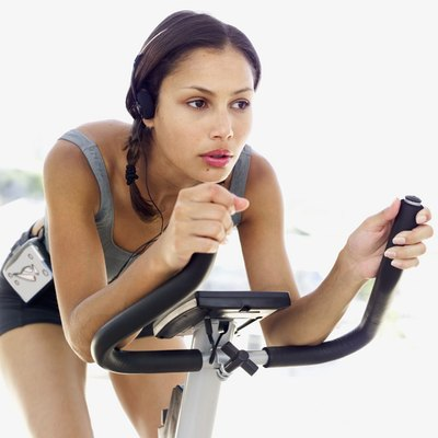 Riding an exercise bike is an effective low-impact, aerobic exercise.