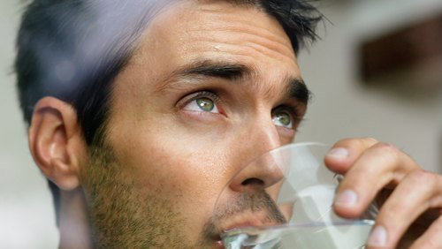 <p>Drink water throughout mowing sessions -- before your body signals it's thirsty.</p>