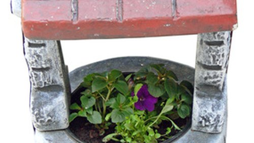 <p>Place large decorative pots around it or on top of it.</p>