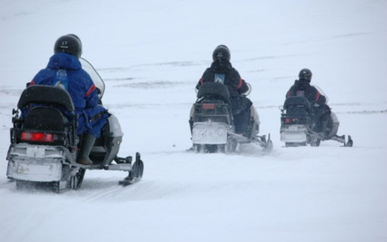 Wintertime activities in Idaho include snowmobiling.