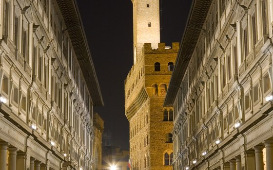 The exerior of the Uffizi Gallery lights up at night.
