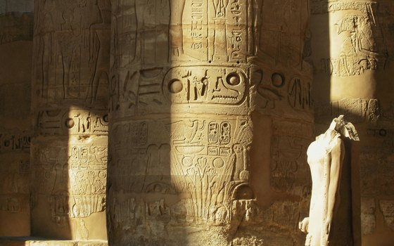 Hieroglyphics and carvings adorn the columns of Karnak's temples.