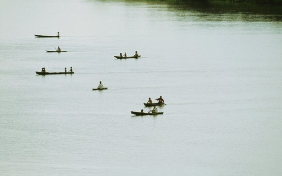 Tourists and locals canoe on the Amazon River in Brazil.