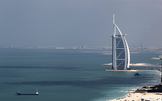 Burj al Arab stands on a man-made island connected to the mainland.