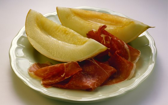 The composed combination of Prosciutto and melon is a traditional Parmesan appetizer.