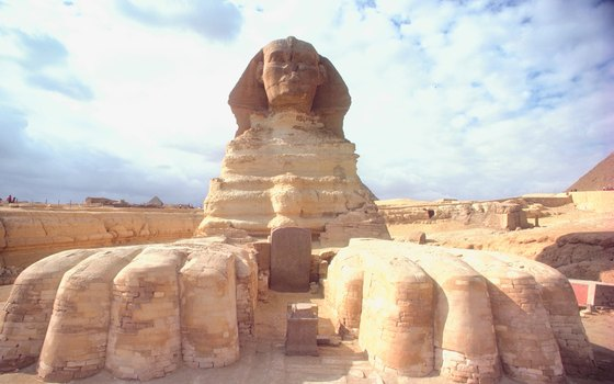 The Sphinx rests its giant paws outside Cairo, Egypt.