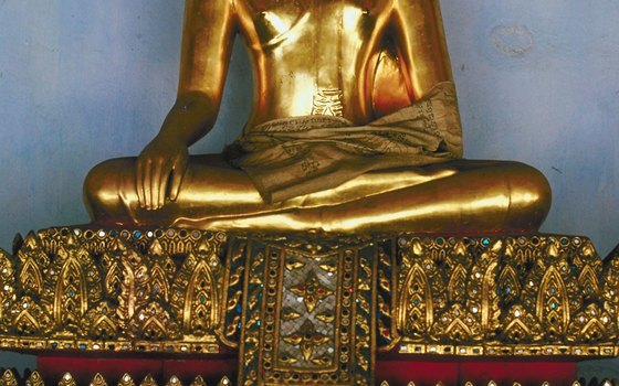 Gold Buddha sits in the Wat Phra Kaew, a temple inside the Grand Palace.