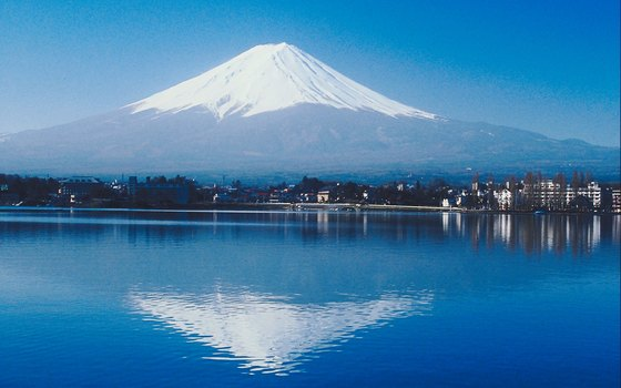 Mount Fuji is reflected in the water of Lake Kawaguchiko.