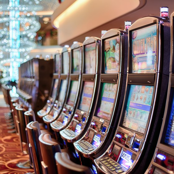 A row of slot machines on a casino floor.
