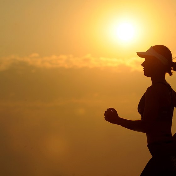 A person jogging as the sun sets.