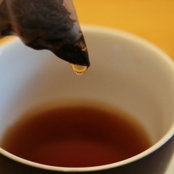 Drink herbal tea with a little sweetener to help dry cough.