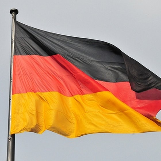 Obtain a German passport at your local Consulate.