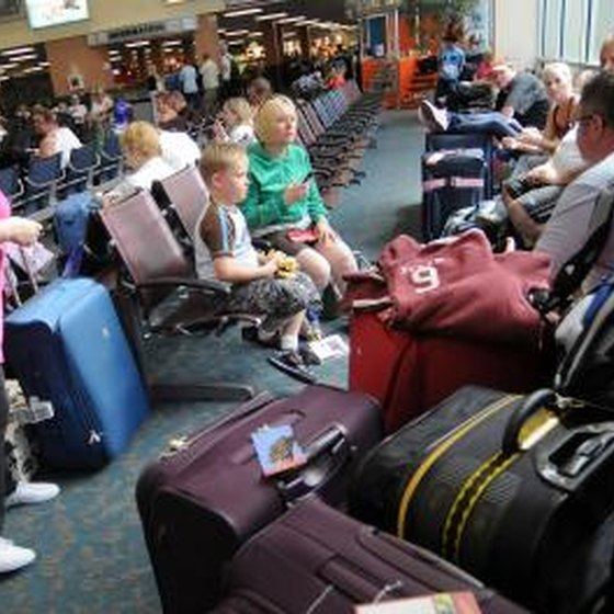 Airline passengers wait for flight at Orlando International Airport.