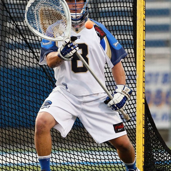 Lacrosse goalkeepers don't wear as much padding as hockey goalies.