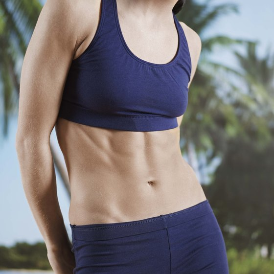 Perform standing abdominal exercises to tone your tummy.
