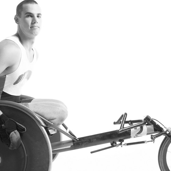 Using a hand bike builds muscle while burning fat.