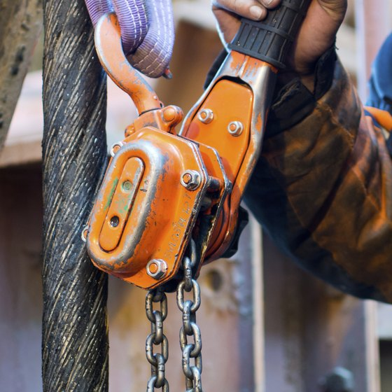 Close-up of man using chain hoist