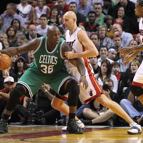 Shaquille O'Neal (No. 36), one of the best centers in NBA history, operates in the low post against Miami in 2010.