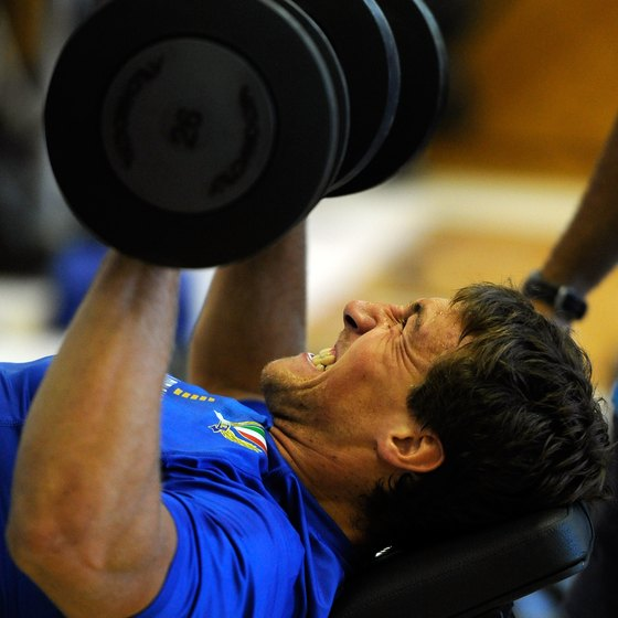 Dumbbell presses can assist your bench press.
