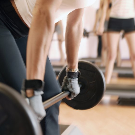 In a conventional deadlift, your legs are behind the bar.