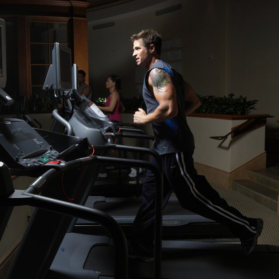 Alternate running with walking during a treadmill HIIT workout.