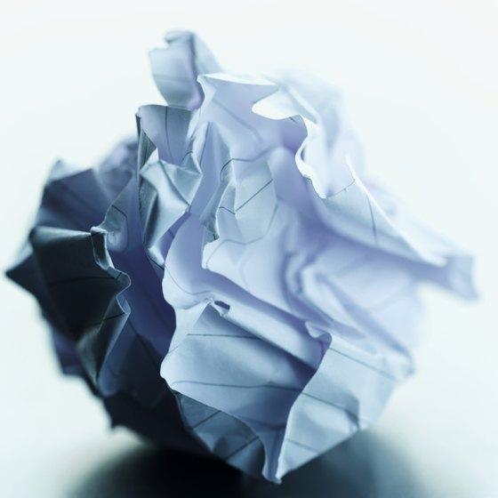 Crumbled paper causes paper jams in a copy machine.