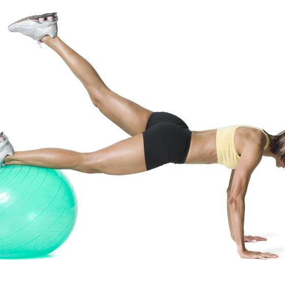 Perform knee-to-elbow planks on a stability ball to boost intensity.