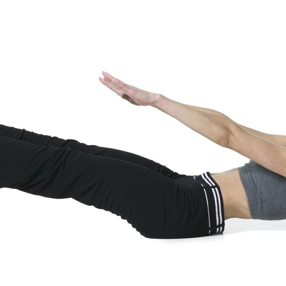 Extending your arms makes crunches more difficult.