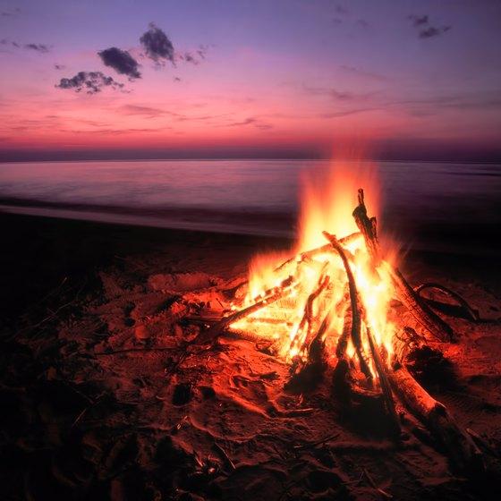 Beach bonfires light up nighttime celebrations.