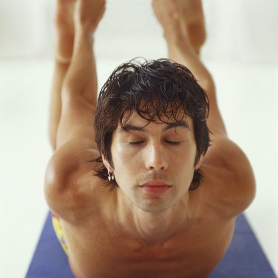 Practitioners perform Bikram yoga in a room heated to 105 degrees.