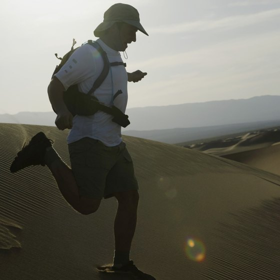 A running backpack has a waist strap and shoulder straps.
