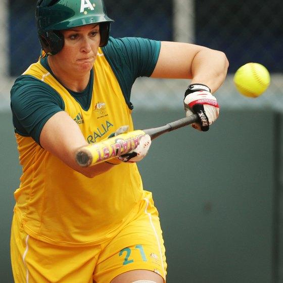 Natalie Ward of Australia's women's softball team lays down a bunt.