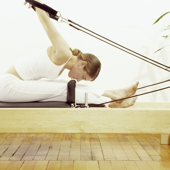Taking classes at a Pilates studio gives you access to machines built for doing Pilates exercises.