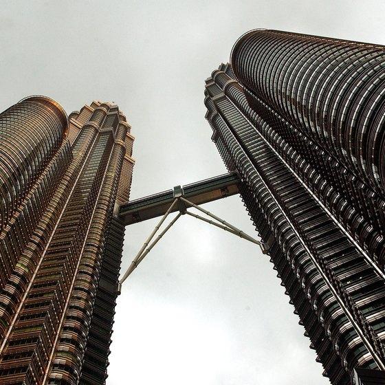 Stand beneath Kuala Lumpur's soaring Petronas Towers.