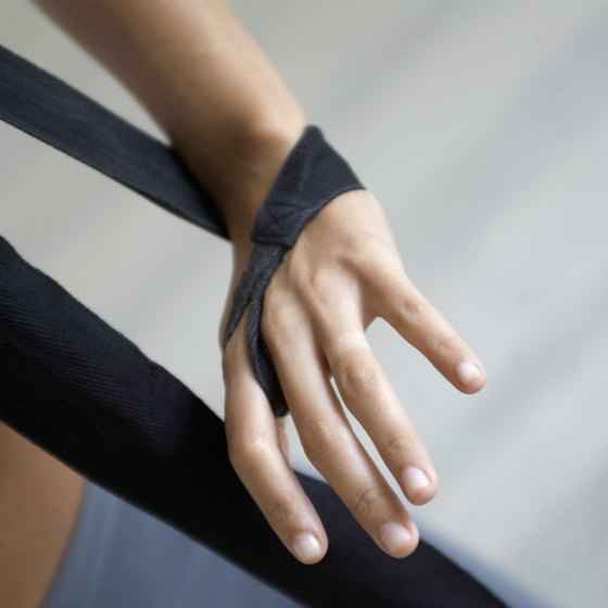 Pullup bands, which resemble large rubber bands, provide assistance during the dip exercise.