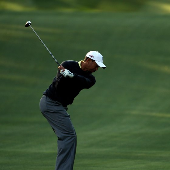 Tiger Woods prepares to attack the ball, using a properly shallow downswing.