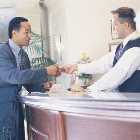 Hotels usually hold deposits through your credit card, but some older or smaller inns might ask for cash.