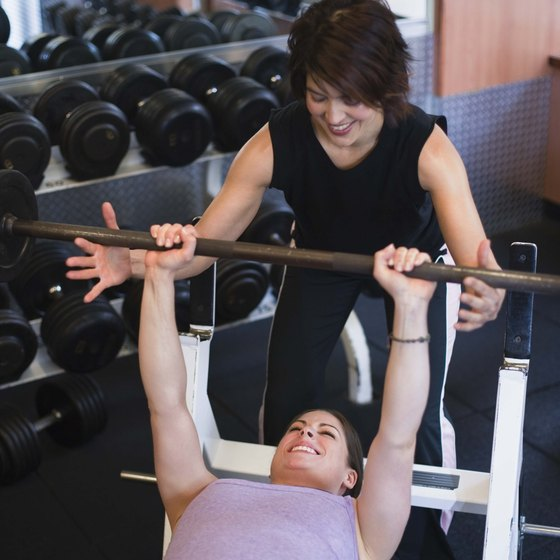 Use a spotter for safety during the chest press.