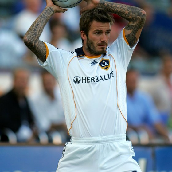 David Beckham of the L.A. Galaxy handles the ball legally on a throw in.