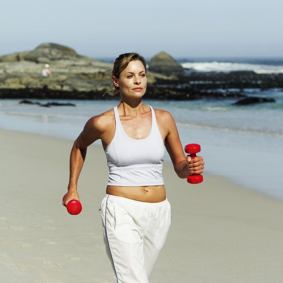 Walking's benefits include lowering blood pressure and cholesterol levels.