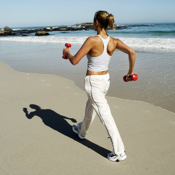 Walking on a beach with dumbbells can be good or bad.