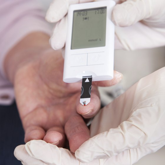 Doctor tests patient's blood sugar level