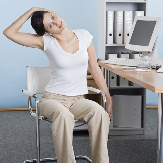 Stretching at your desk can energize you during work hours.