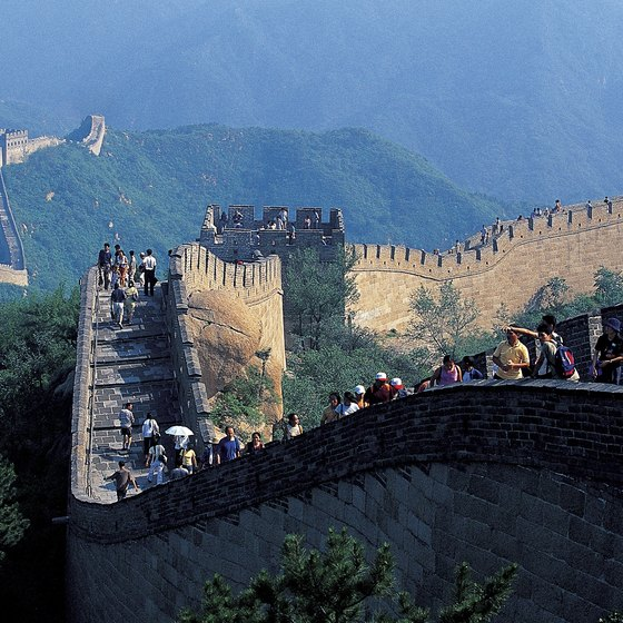 Tourists are walking on the Great Wall.