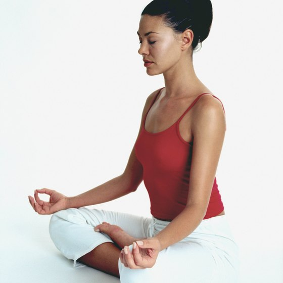 A Sivananda yoga session is often initiated through meditation.