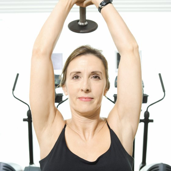 Overhead triceps extensions can tighten the back of your upper arms.